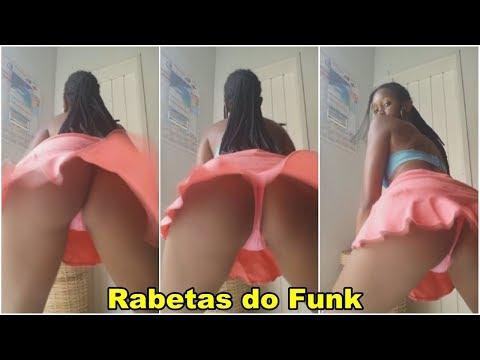 Novinha gostosa dançando funk de sainha mostrando a calcinha